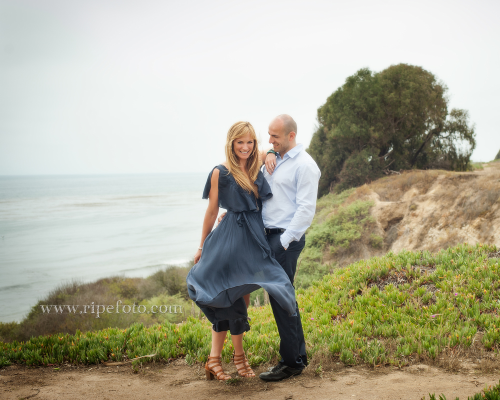 Portrait of couple overlooking the Pacific Ocean in Santa Barbara by engagement photographers at Ripe Photography.