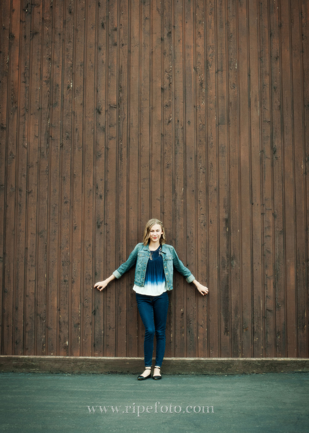 High school senior portrait of girl on wooden background by senior portrait photographers at Ripe Photography in Portland, Oregon.