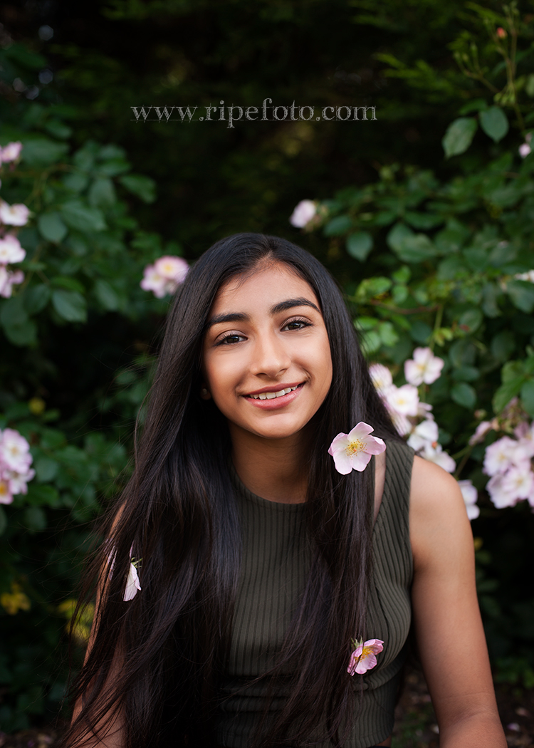 Portrait of teen on roses background by teen photographers at Ripe Photography in West Yorkshire, England.