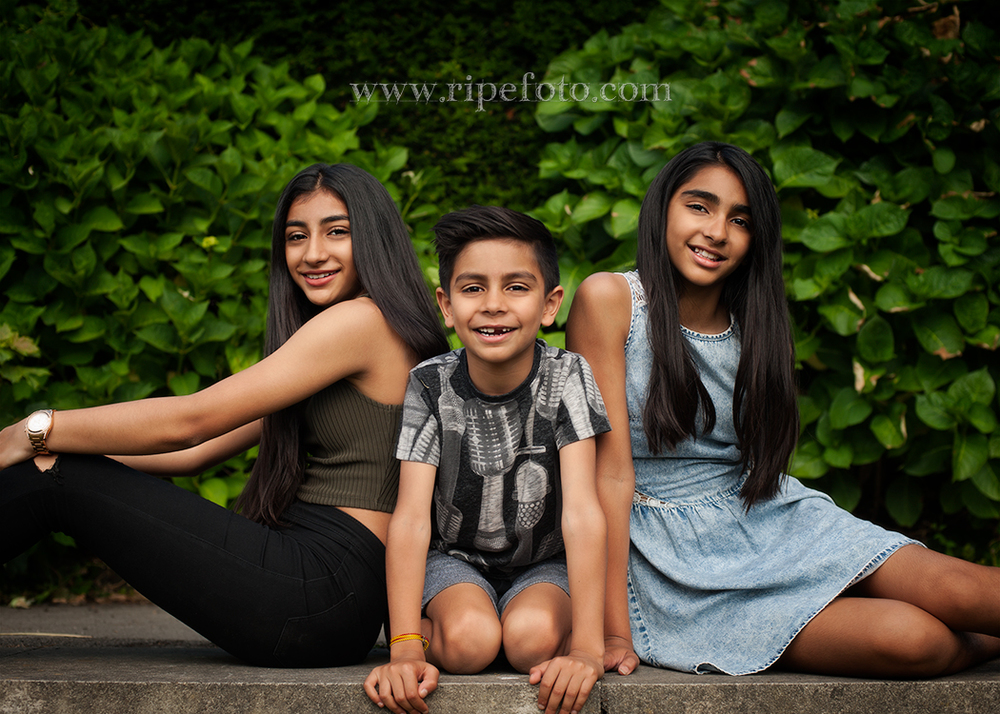 Portrait of children on greenery background by children's photographers at Ripe Photography in West Yorkshire, England.