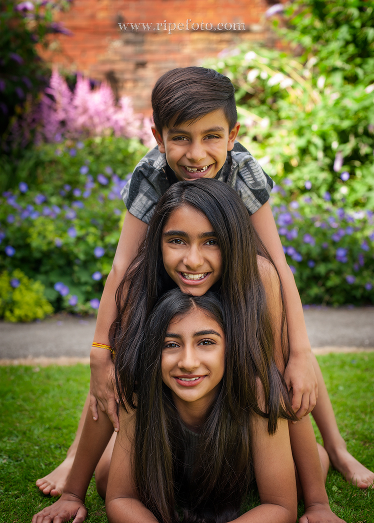 Portrait of children on flowers background by children's photographers at Ripe Photography in West Yorkshire, England.