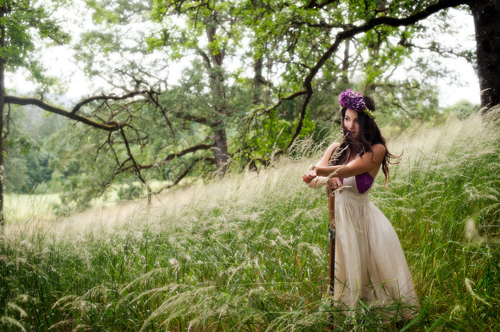 Creative portrait of young woman in forest by photographers at Ripe Photography in Portland, Oregon.