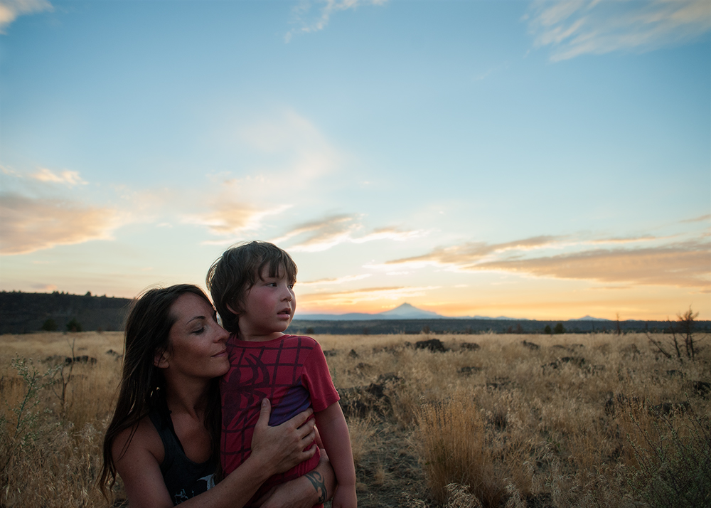 Wild portrait of mother and child in Oregon's high desert with Mt. Jefferson in the background by portrait photographers at Ripe Photography in Portland, Oregon and the United Kingdom.