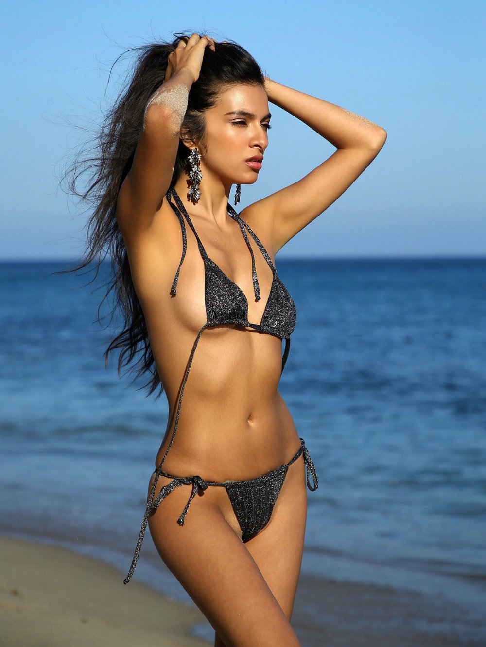 Kasos Metallic Brazilian Bikini - Black Silver/Gunmetal Silver Metallic Brazilian BikiniExclusive FabricComposition: 62% PA 29% PM 9% EADark Grey Lining: 75% PA 25% EASize Small to Medium bustSize Small bottom