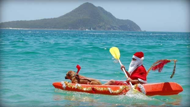 santa-in-canoe.jpg