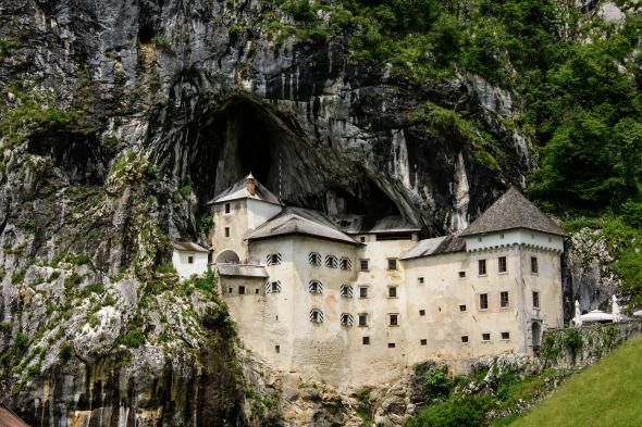 The Predjamski Grad castle sits tucked into the mouth of a cave near the start of the Via Dinarica in Postonja, Slovenia.  PHOTOGRAPH BY SEAN MCDERMOTT, NATIONAL GEOGRAPHIC