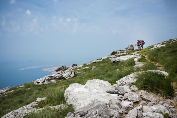 Two hikers pause along the trail near the Velebit mountains.  PHOTOGRAPH BY LOIS PARSHLEY, NATIONAL GEOGRAPHIC