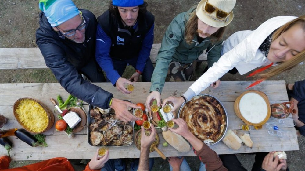 Travellers sharing lunch in the Macedonian village of Galičnik. Image by © courtesy of Novagenus
