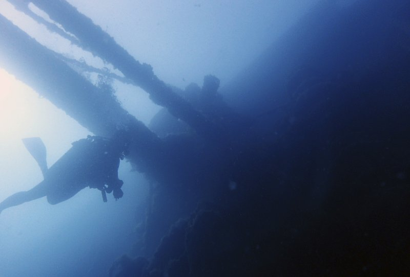 A diver swims under part of the Italian World War II shipwreck MV Probitas in Saranda Bay, southern Albania. On the seabed off the rugged shores of Albania, one of the world's least explored underwater coastlines, lies a wealth of treasures. Ancient amphorae that carried olive oil and wine; wrecks with hidden tales of heroism and treachery from two world wars; spectacular rock formations and marine life. (AP Photo/Elena Becatoros)