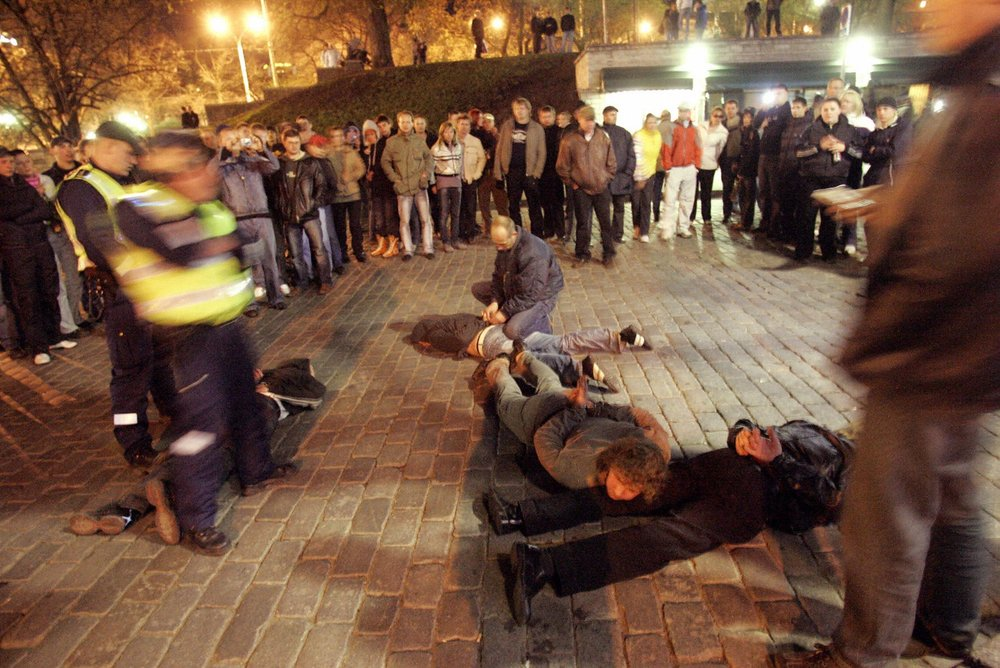 Russian rioters handcuffed by police, Tallinn, Estonia 2007. Photo: STRINGER/AFP/Getty Images