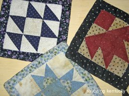 Well-used quilt-piece potholders