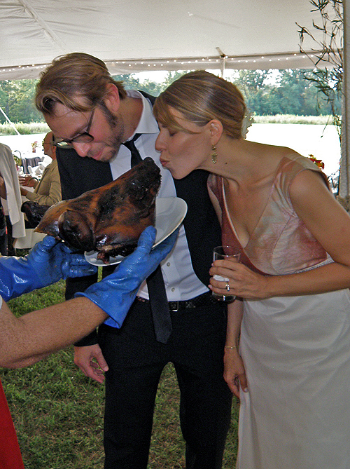 Lynn Peemoeller and Eric Ellingsen ceremoniously kiss the pig at their 2010 Shakertown wedding