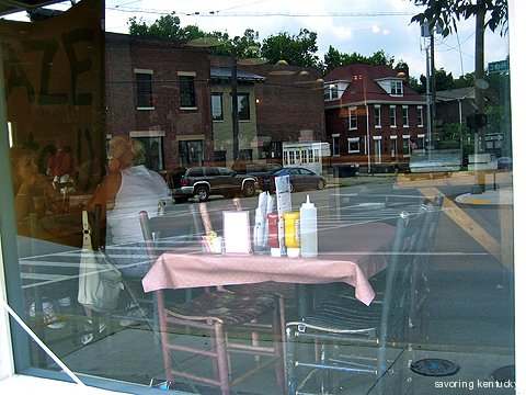 Neighborhood reflected in Ramsey's Diner window, Woodland area, Lexington, Kentucky