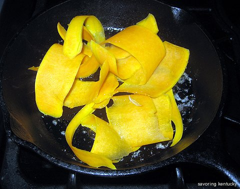Cooking Butternut Squash Ribbons in a black iron skillet