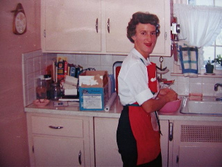 Catherine Seiberling Pond's mother in her kitchen