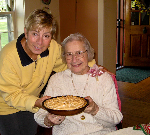 Theresa Kremer offers her mother a homemade lemon meringue pie on Mothers' Day
