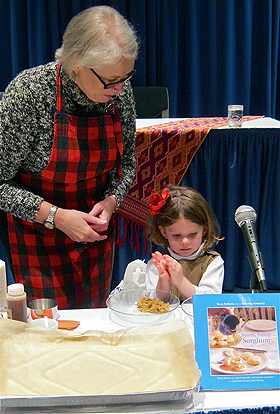 Four-year old cook Abigail rolls out Sorghum Crinkles