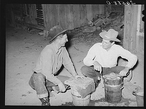 Men of Pie Town, New Mexico, churn ice cream in 1940