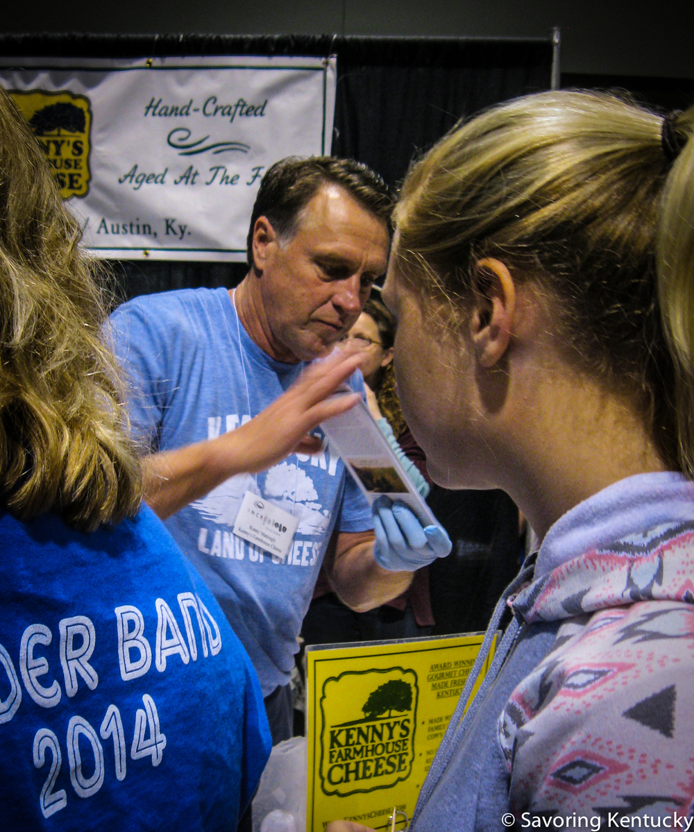 Kenny Mattingly, center, of Kenny's Farmhouse Cheese, meeting customers at the 2014 Kentucky Proud Incredible Food Show, Lexington, Kentucky