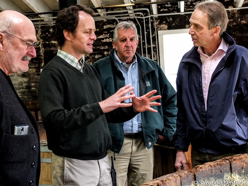 Corn is a grass, right? And bourbon must be at least 51 percent corn....David Wilson, right, tours Woodford Reserve's distillery