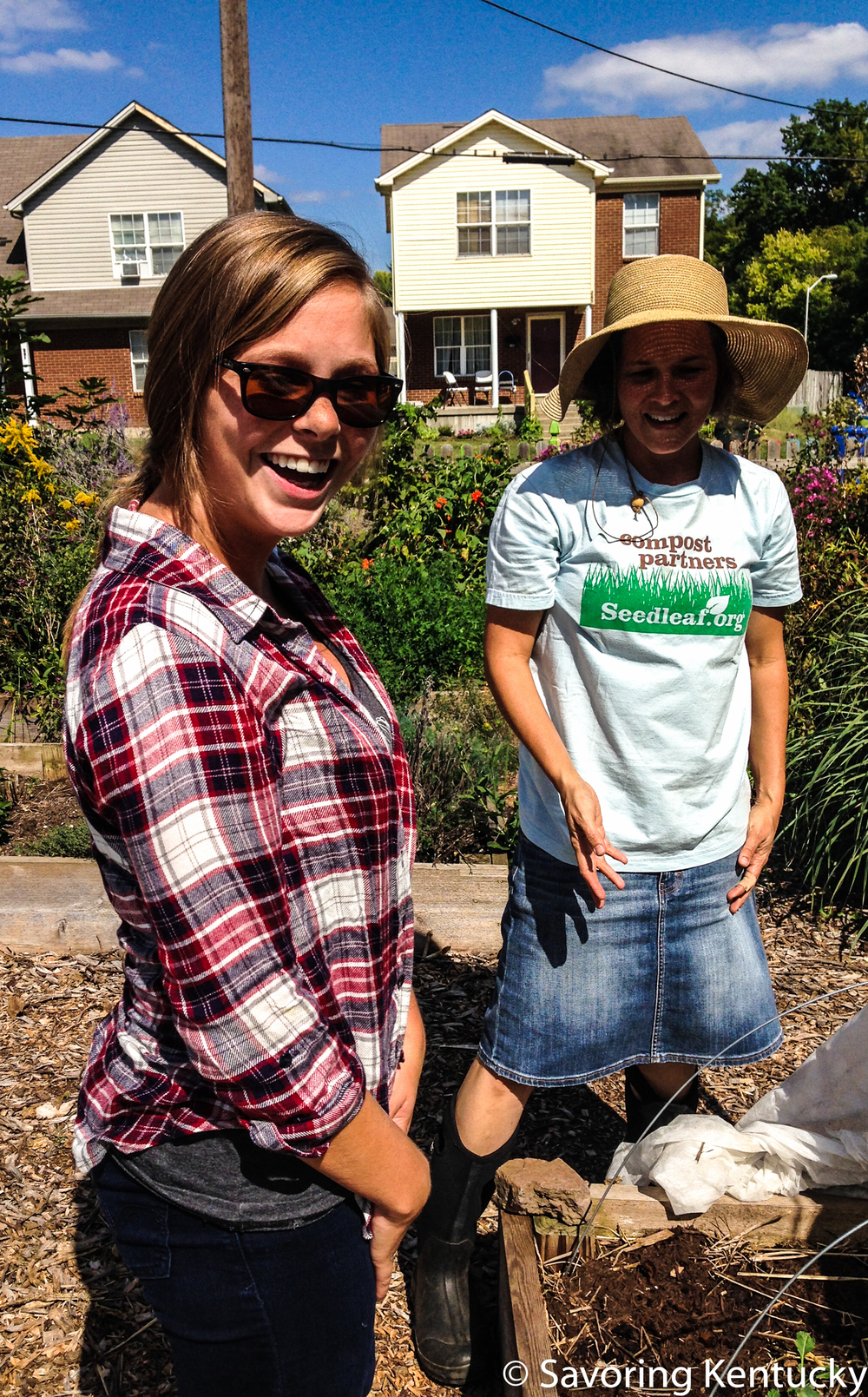 Morgan Miller, left, visits with Sherry Maddock at  The 4th Street Farm  in downtown Lexington.