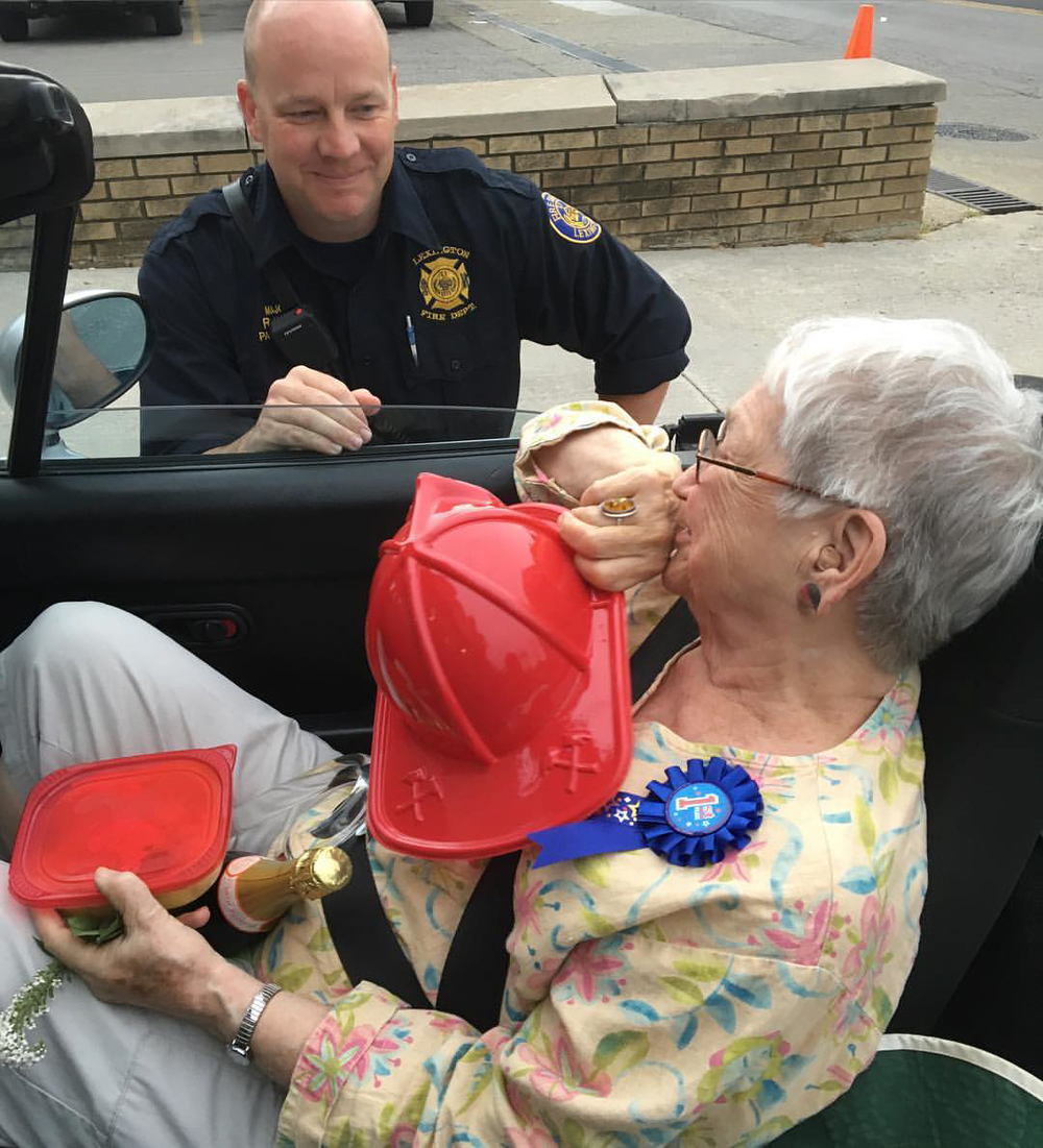 Champion pie maker Loris Points takes a victory lap through Lexington, receiving gifts and praise at every stop. Here Major Robert King of the Lexington Fire Department may have just handed her a stylish firefighter's chapeau.  Photo Credit:  Mick Jeffries  -- Thank you!