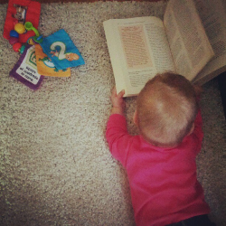 Baby reading about babies.jpg