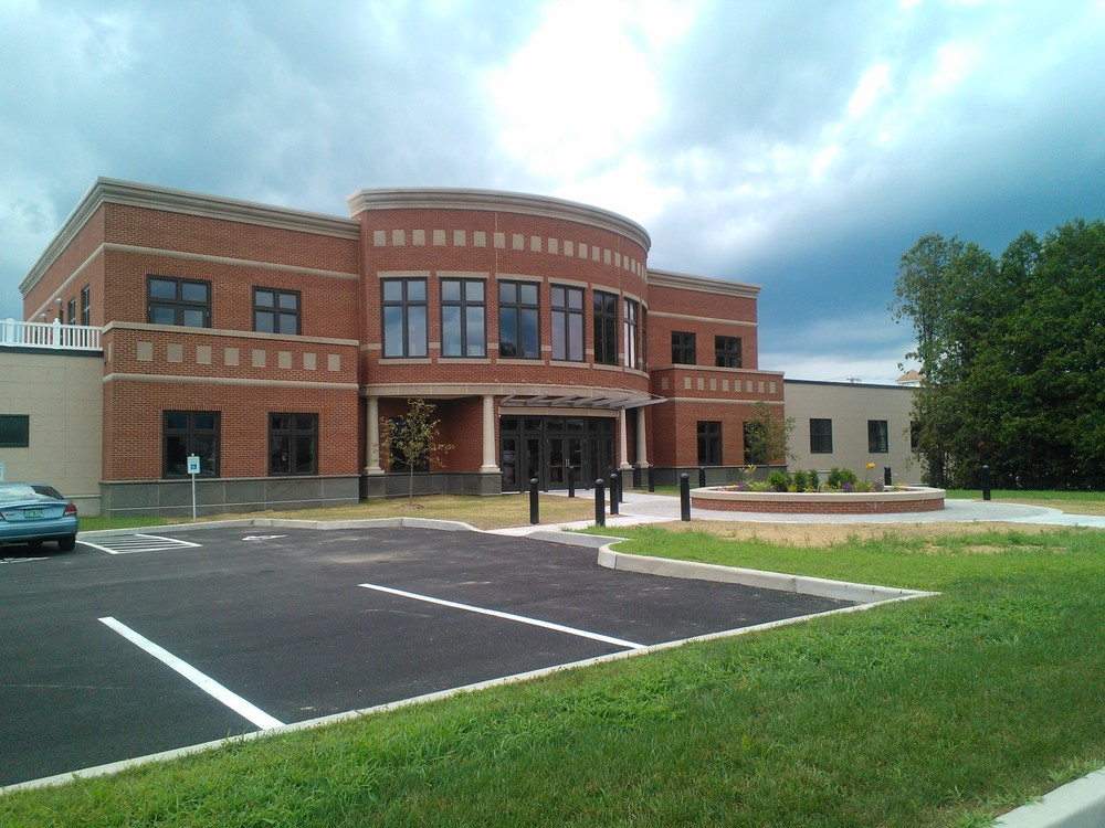 Heritage Family Credit Union, Rutland, Vermont  Engineering for a 26,000 sq. ft. two story bank headquarters/operations central data center.  Work included radiant floor heat - low water temperature distribution, VAV ventilation and air conditioning, light well and day lighting controls.