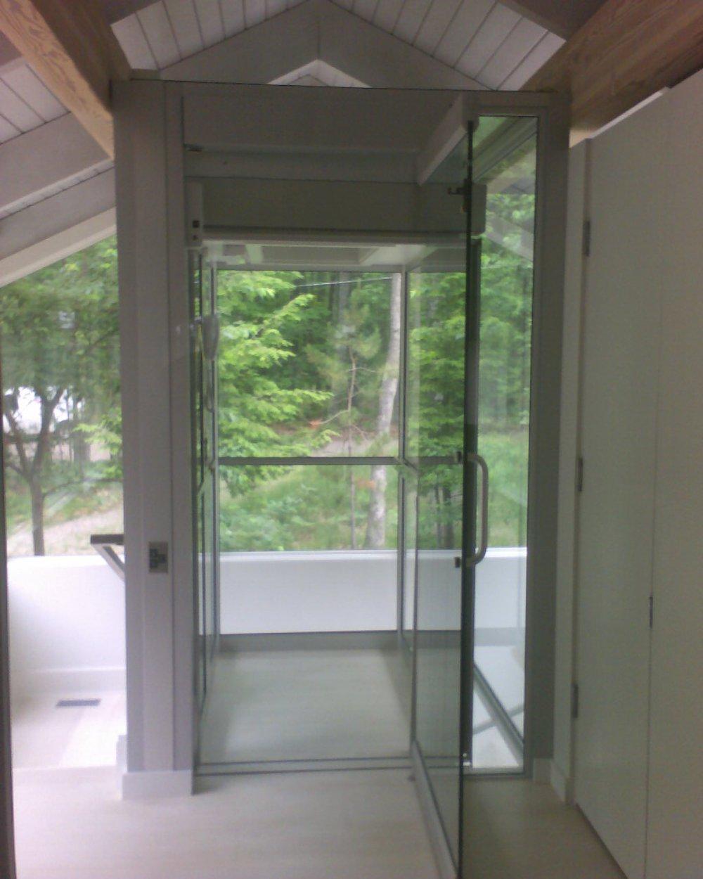 Residential Glass Elevator at Upper Floor with Gate & Door Open