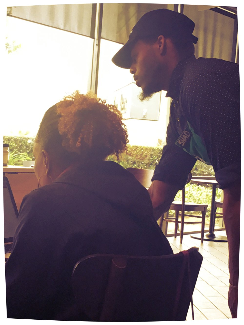 A barista at my local Starbucks helping a customer connect to her wi-fi