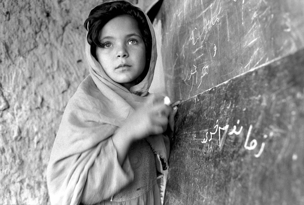 Afghan Girl in Classroom. Source: UN Photo