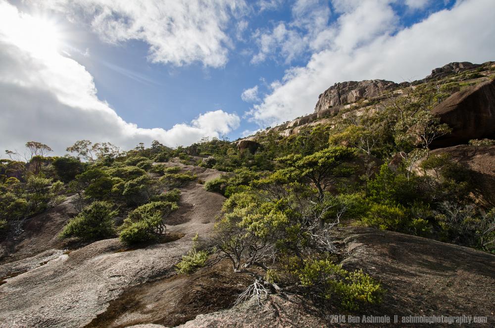 Climbing Mt Amos, Freycinet National Park, Tasmania, Australia