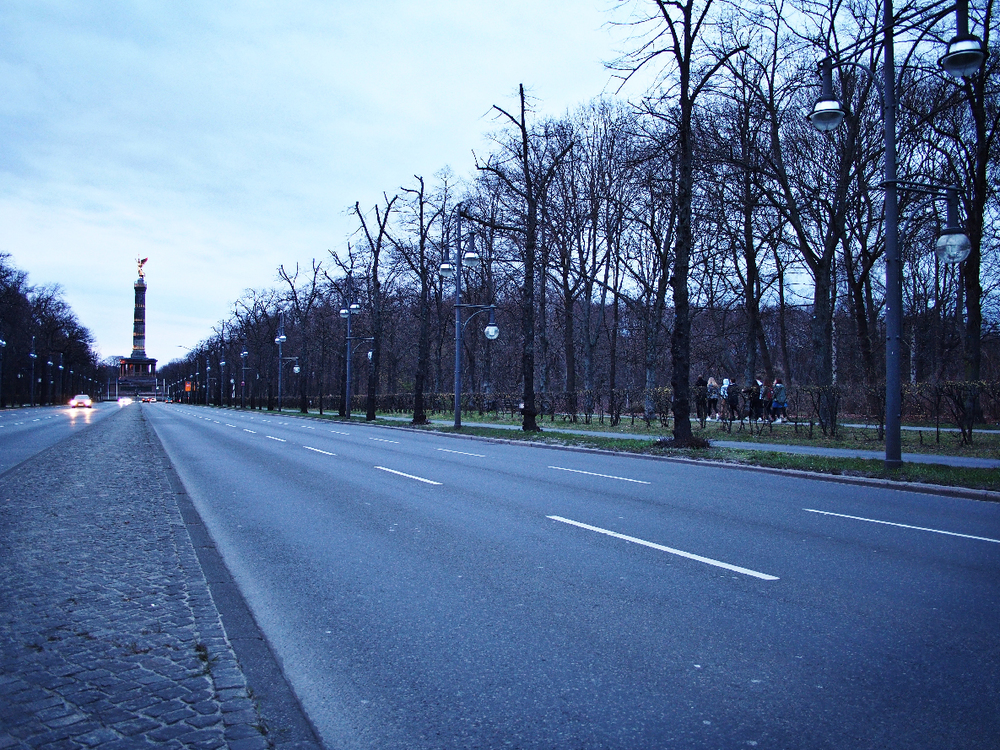 Students walk toward the Franko-Prussian War Memorial in Berlin, Germany.