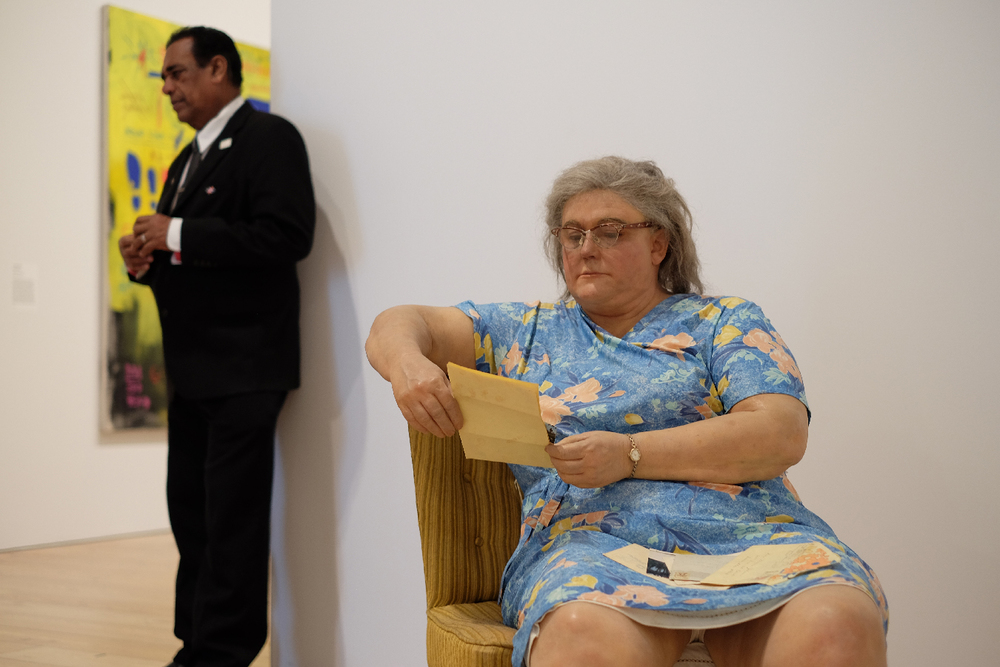 One of these is a sculpture. Amazing realism by Duane Hanson.