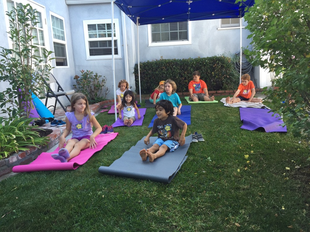 Kids having fun learning yoga at the Pop Up - Iyashi Wellness Kids event in 2015