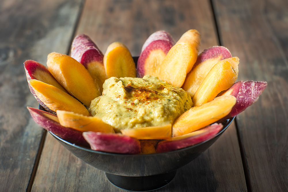 Hummus with sliced Multi-colored organic carrots