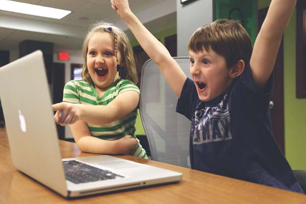 These aspiring freelancers just landed their first client. They are pretty excited... Photo courtesy of Startup Photos