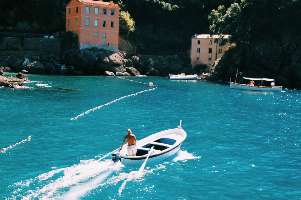 Local on boat in bay of San Fruttuoso, Parco Naturale Regionale di Portofino.