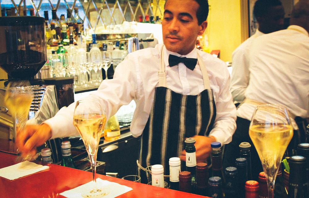 Champagne at the bar. La Petite Maison.