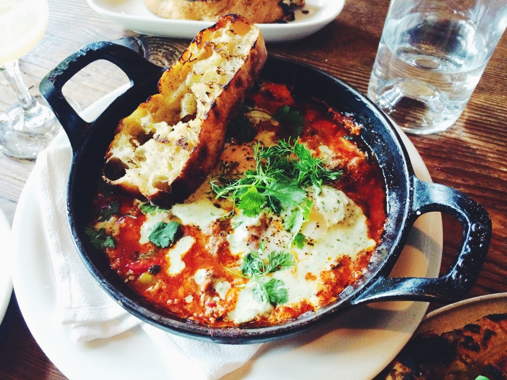 Moroccan baked eggs, merguez, chili, tomato sauce, cilantro & spiced yogurt brunch at Gjelina.