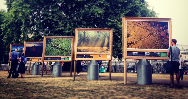 "The stunning images from p hotographer  Michael St Maur Sheil's ""Fields of Battle, Lands of Peace 14-18"" exhibition. The photo on the far right is an aerial view of  trenches and shell holes in Beaumont Hamel, a French fortress village located just behind the German lines.  © Eileen Hsieh"