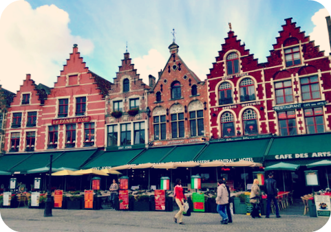 Colorful buildings on Bruges' main square.  © Eileen Hsieh