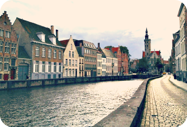 A beautiful cobblestone street traces along the canal in Bruges. © Eileen Hsieh