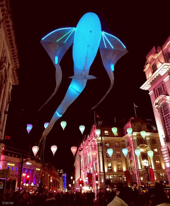 A giant fish dances above Piccadilly -Luminéoles by Porté par le vent
