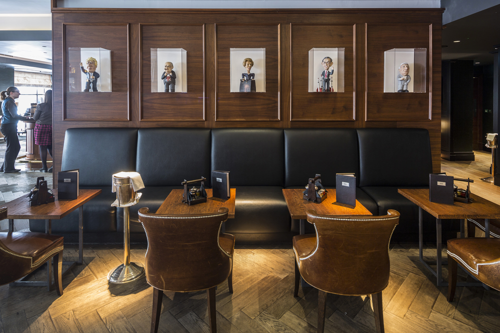 Humorous political caricatures are part of the Blue Boar's charming decor. (Image: Blue Boar Restaurant)