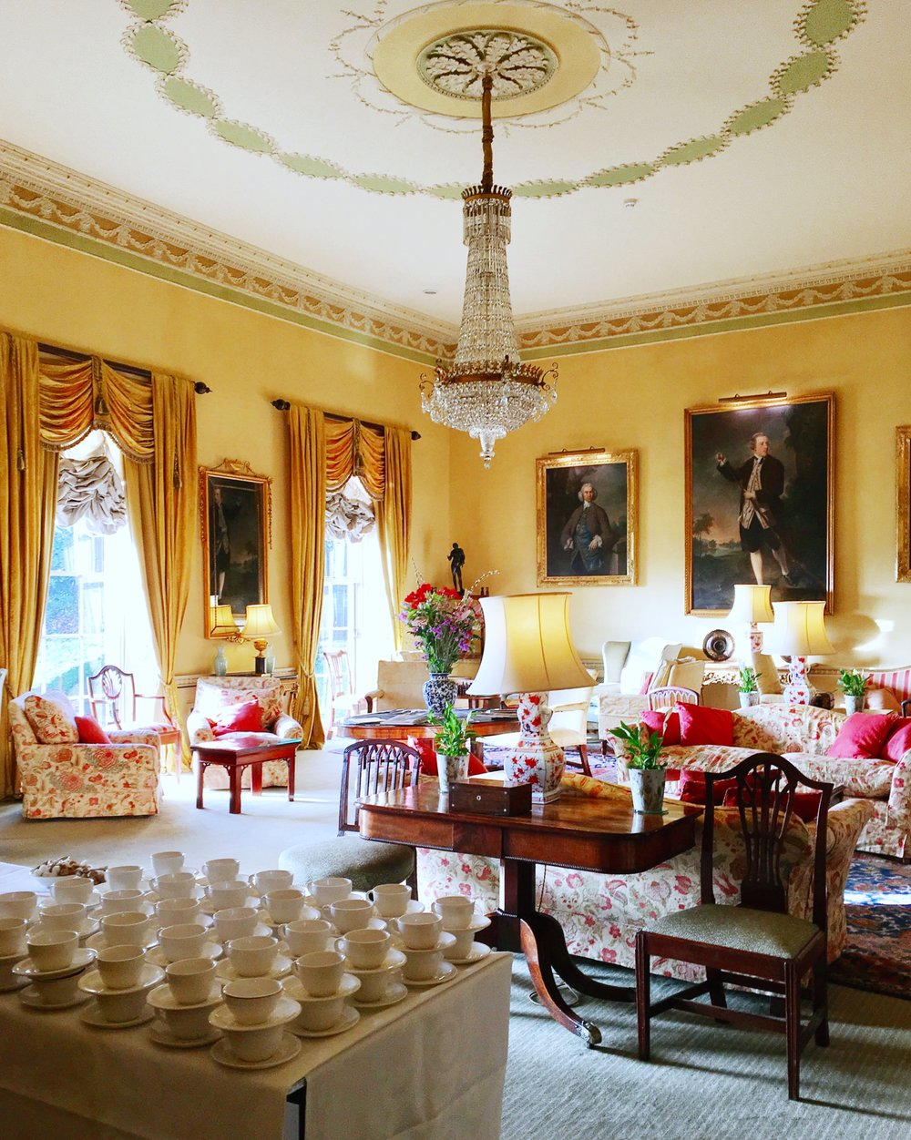 The airy grand reception room with happy, yellow walls. © Eileen Hsieh / Follow That Bug