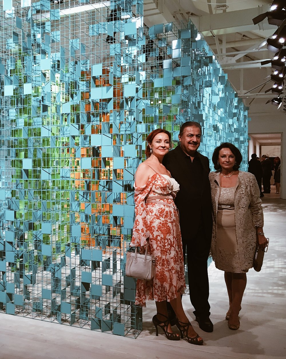 Artist Rashid Khalifa posing with guests in front of his colourful maze. / Photo: Eileen Hsieh