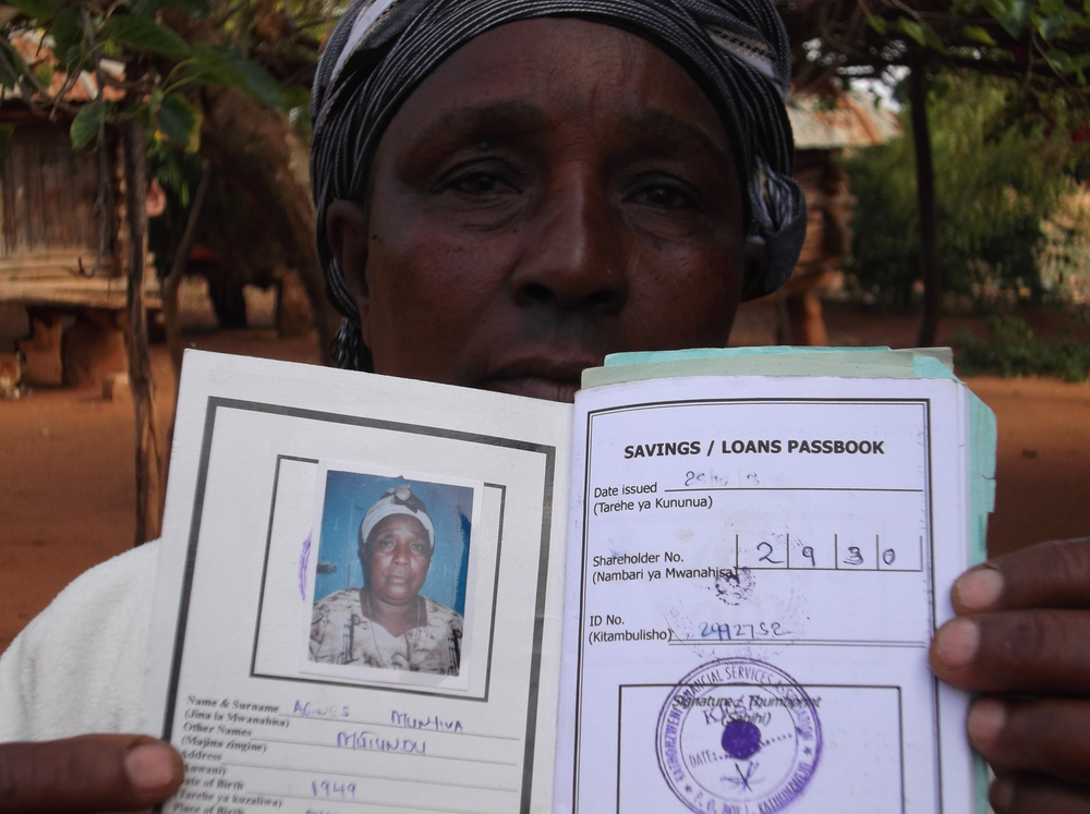 My grandmother is holding the documents from the bank which show we are saving some of the money for my future.  © Musyoka 2012 / ODI / PhotoVoice