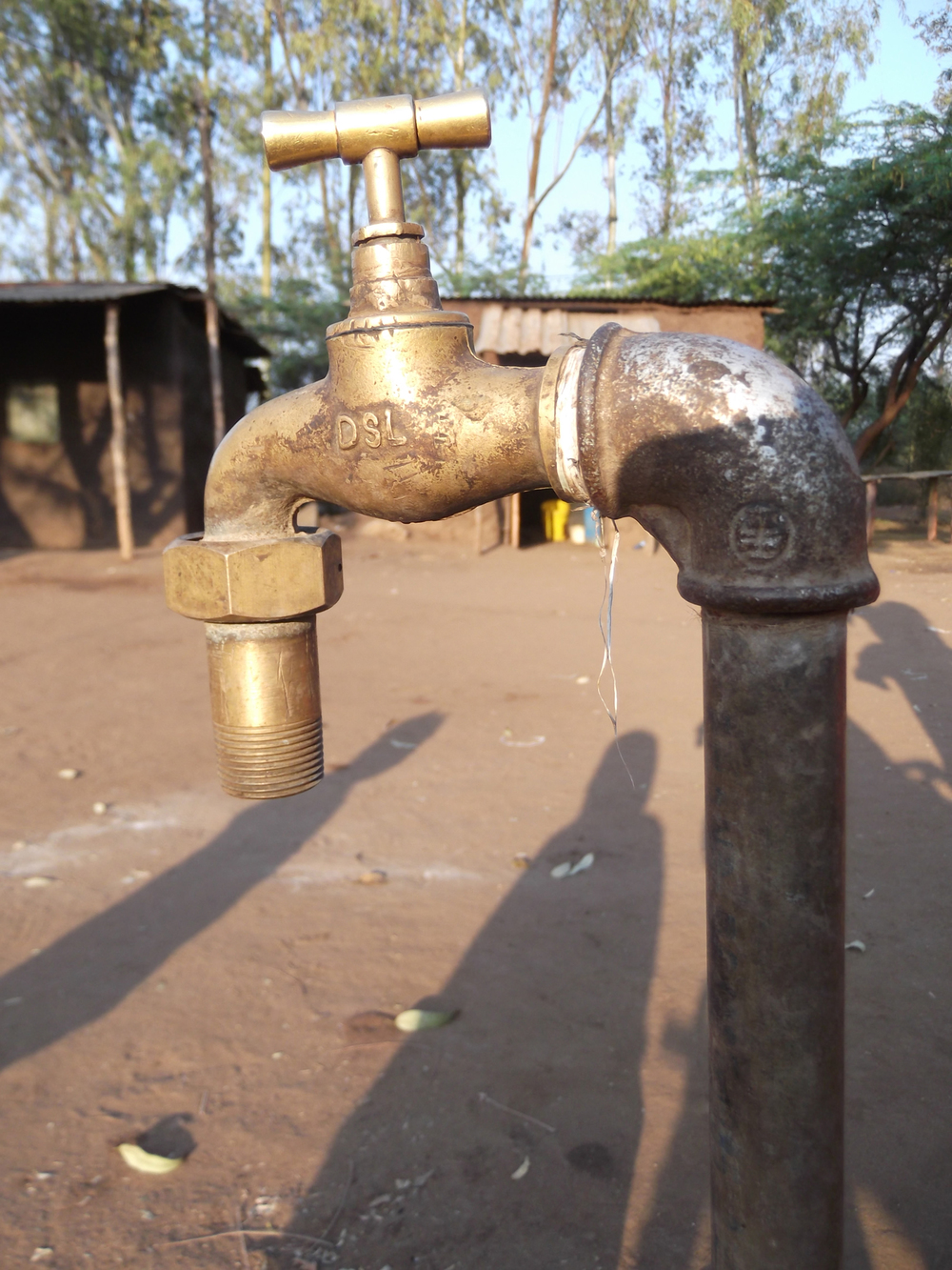 I saved up to get a tap installed for the house, which I didn't have before.  © Linda Sarmento Manjaze 2012 / ODI / PhotoVoice