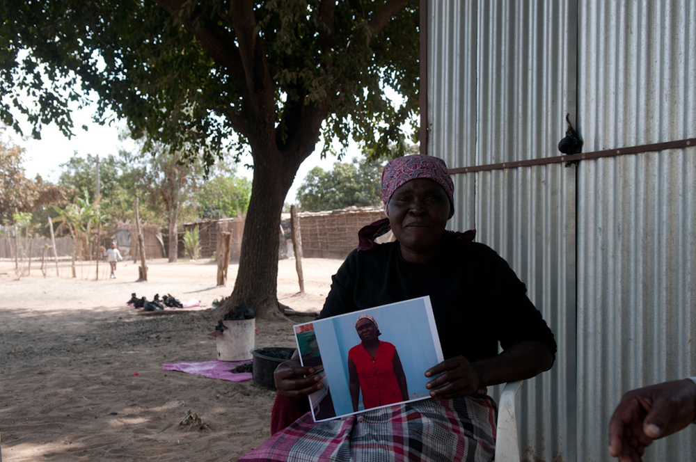 Celeste proudly displaying her printed self-portrait, Chokwe, Mozambique  © Gloria Santos 2012 / ODI / PhotoVoice